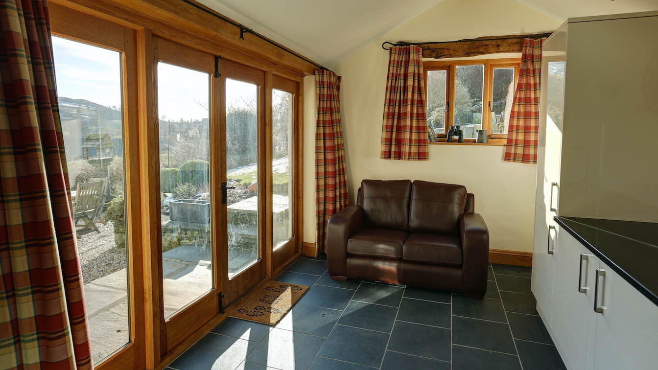 19 Townfoot Farmhouse, Troutbeck - Lake District, Dog-friendly holiday cottage - Garden room with views over Troutbeck valley-sqz