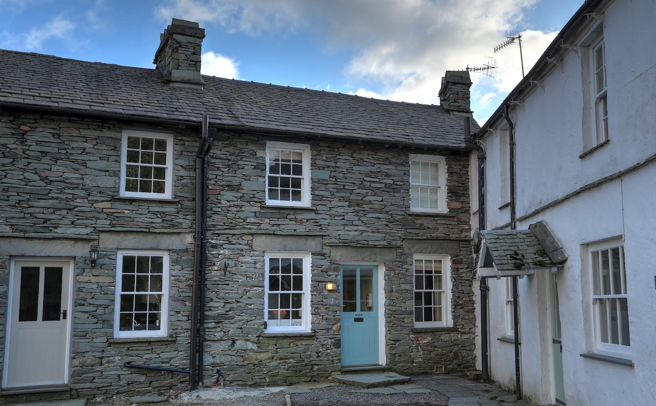 20 Townfoot Cottage, Elterwater - Tesla and EV charging parking spage. Lake District, Dog-friendly Elterwater holiday cottage - Stonework of the outside of the cottage, adjacent to the parking bay-sqz