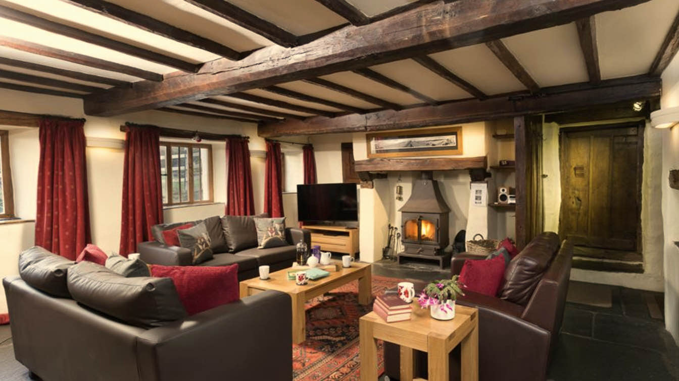 3 Townfoot Farmhouse, Troutbeck - Lake District, Dog-friendly holiday cottage - Lounge with log burner-sqz